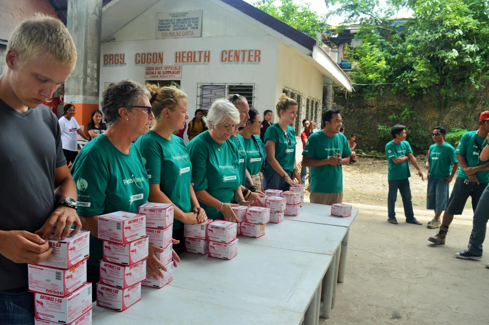 A group of volunteers providing free healthcare to a local community in The Philippines.